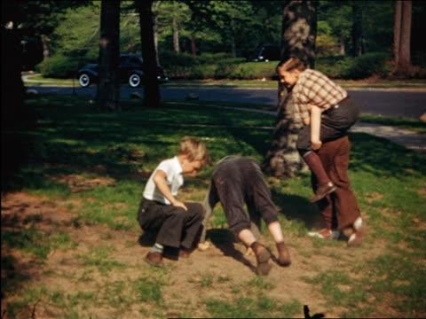1940 boys wrestling + riding piggyback in yard / Maplewood, NJ / home movie