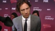 INTERVIEW Brad Falchuk on if the series is scary on horror and comedy together and on the female cast at the 'Scream Queens' Los Angeles Premiere...
