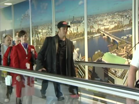 Brad Pitt and a pregnant Angelina Jolie fly into Heathrow from Los Angeles at the start of their relationship Long walk through airport with children...