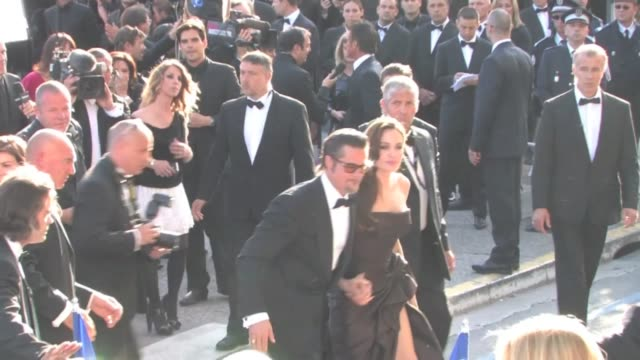 Brad Pitt and Angelina Jolie signing tons of autographs Hollywood's hottest couple climb the stairs of the 64th Cannes Film Festival for Tree of Life...