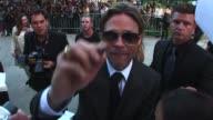 Brad Pitt signs the camera lens at the Red Carpet for the film Premier of MONEYBALL at the 2011 Toronto International film Festival TIFF Brad Pitt at...