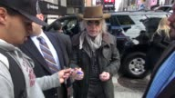Brad Whitford of Aerosmith signs for fans outside VH1 in New York NY on 11/02/12