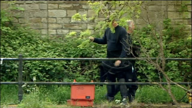 General views of police officers and police divers searching in and around the River Aire