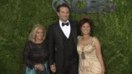 Bradley Cooper poses with his mom Gloria Campano and his sister Holly Cooper at 2015 Tony Awards Arrivals at Radio City Music Hall on June 07 2015 in...