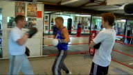 Bradley Saunders in training for Olympics Setup shots of Saunders sparring in ring with Kerr and his father Interview with Saunders SOTas he spars...