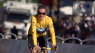 Bradley Wiggins riding up the Champs Elysees after stage 20 of 2012 Tour de France