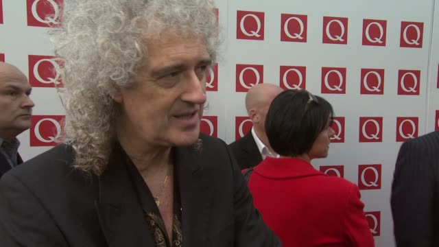 Brain May on Qeen's remasterd album Q Awards and The Darkness at the The Q Awards 2011 at London England