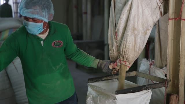 Bran is packaged at the Amru Rice Co processing factory in Battambang Cambodia on Wednesday Aug 9 2017 Photographer Brent Lewin Shots wide shot of...