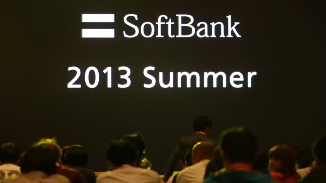 Branding for 'SoftBank 2013 Summer' is displayed at a product launch in Tokyo Various shots Masayoshi Son president of SoftBank Corp speaks on stage...