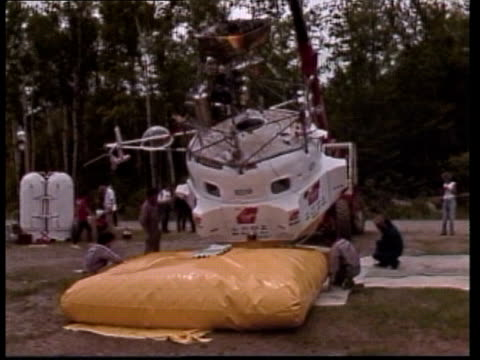 Branson balloon Maine Sugarloaf Mountain MS Capsule tilting as 2 men to BV in F/G CMS SIDE man crouching speaking SOF LMS Capsule tilting as men...