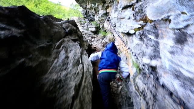 Brave kid on mountain trail