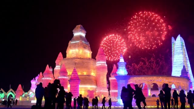 Brave swimmers plunge into freezing waters while others gaze at frozen palaces as Chinas spectacular Harbin Ice and Snow Festival opens