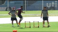 England team training Raheem Sterling along during training / Steven Gerrard in training and warming up with teammate / Alex OxladeChamberlain in...