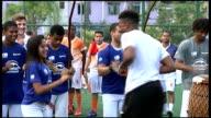 England team visit shanty town BRAZIL Rio de Janeiro Rocinha favela EXT Various shots of Danny Welbeck and Daniel Sturridge attempting to perform...
