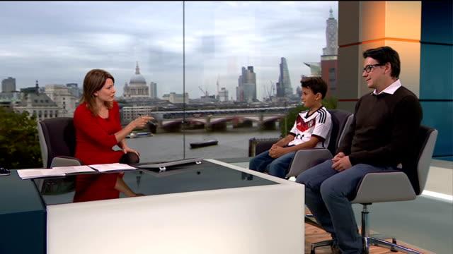 London schoolboy to be mascot at World Cup final ENGLAND London GIR INT Alexander Degtiarev and Igor Degtiarev LIVE studio interview SOT