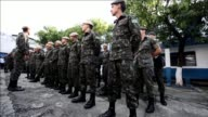 Brazilian soldiers and agents from Sao Paulos Public Health Secretariat take part Wednesday in a clean up operation against the Aedes aegypti...