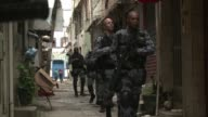 Brazilian soldiers began to withdraw from a sprawling Rio slum on Wednesday a year after being deployed to help clean up the neighborhood ahead of...