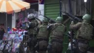 Brazilian soldiers deployed by armored vehicle truck and helicopter Friday to reinforce police after heavily armed drug traffickers rampaged through...