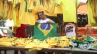 MS Brazilian team merchandise is offered for sale in the Mare favela complex currently occupied by the Army ahead of the 2014 FIFA World Cup on June...