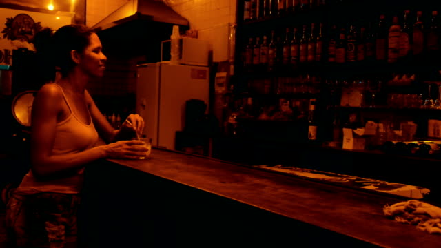Brazilian woman at the bar drinking cocktail