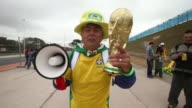 Brazilians prepare to celebrate World Cup festivities on June 11 2014 in Sao Paulo Brazil