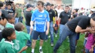 Brazil's former player and coach Dunga takes part in the inauguration of sports fields to promote football in working class districts of the...