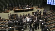 Brazil's lower house of Congress opens its debate on whether to send scandal plagued President Michel Temer to face trial on a corruption charge
