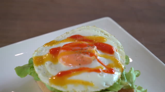 bread toast with fried egg and vegetable