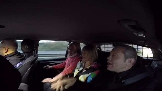 Breast cancer sufferer's Carpool Karaoke videos are viral hit INT Taylor and men singing in back of police car SOT