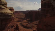 Breathtaking flight through tower rock formations at Cannyonlands National Park Utah