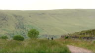 Brecon Beacons soldiers deaths one soldier named Brecon Beacons Sign 'Pen Y Fan' GV Hills and two walkers along in distance Steve Lloyd interview SOT...