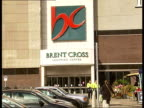 Brent Cross shopping centre and surrounding areas EXT Sign and entrance to Brent Cross shopping centre / Car park / People at cafe / Traffic along...