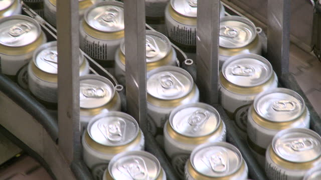 CU Brewery of tins on conveyer belt in Warsteiner AG / Warstein, North Rhine Westphalia, Germany