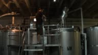 LS Brewmaster Nik Mebane adds yeast to a fermenting tank at Wynwood Brewing Company on April 25 2014 in Miami Florida Earlier this week Florida...