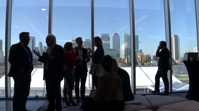 business concerns about 'no deal' Brexit ENGLAND London CBI Conference venue Conference delegates stand chatting in atrium area Canary Wharf...