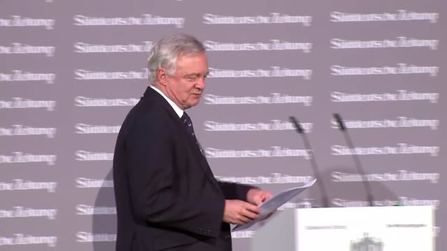 David Davis warns against 'putting politics above prosperity' GERMANY Berlin EXT Cyclists along past the Reichstag Lamp outside Reichstag building...