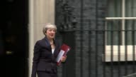 Draft of Government plans for immigration leaked from Home Office ENGLAND London Downign Street EXT Theresa May MP from Number 10 and into car