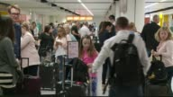 EU citizens to continue to be allowed visa free travel to the UK LIB / 2172017 West Sussex Gatwick Airport INT Various shots of passengers queuing in...