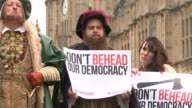 European Union Withdrawal Bill accused of giving ministers too much power Westminster EXT Various shots Henry VIII statue Various of protesters...