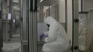 Fears over science funding and employment T30031536 / 3032015 Cambridge Various of scientist wearing protective clothing pouring out graphene poweder...