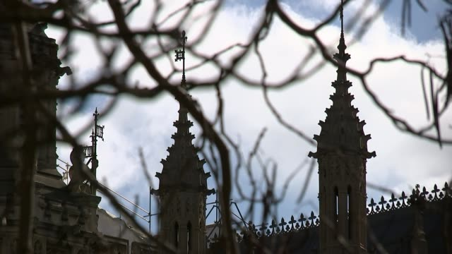 Fears of EU nationals living in the UK EXT Low angle shot Burghers of Calais statue with Victoria Tower behind Long shot Houses of Parliament seen...