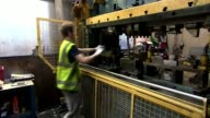 Government sets out plans for future customs system with EU Warwickshire Workers at machine at metal pressing workshop Various of workers at machines...