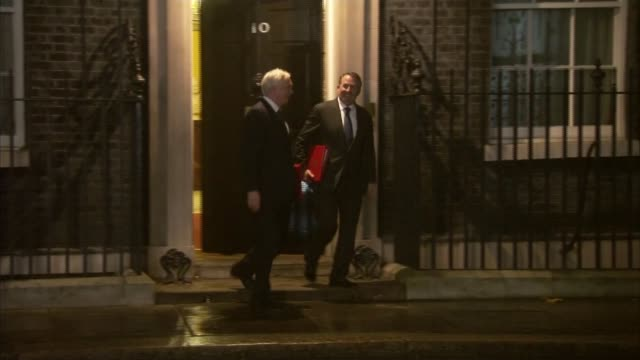 Government 'willing to double Brexit divorce bill offer to 40 billion pounds' EXT David Davies MP and Liam Fox MP leaving Number 10 Foreign Secretary...