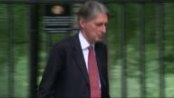 Governor of the Bank of England Mark Carney warns of sluggish UK economy Downing Street EXT Philip Hammond along to Number 10