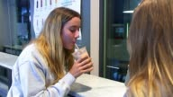 Governor of the Bank of England Mark Carney warns of sluggish UK economy Women drinking mocha drink in coffee shop