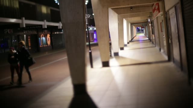Portrait of political bellweather town Basildon **Music heard SOT** Shopping arcade High angle view man in empty square Pipework on building