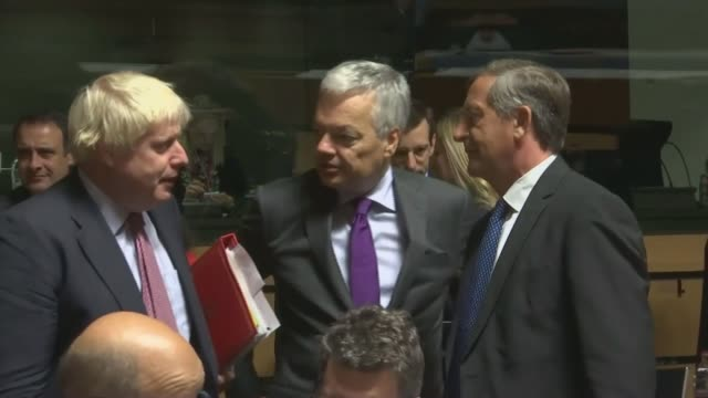 Theresa May and JeanClaude Juncker talks BELGIUM Brussels INT Foreign Secretary Boris Johnson standing chatting with others