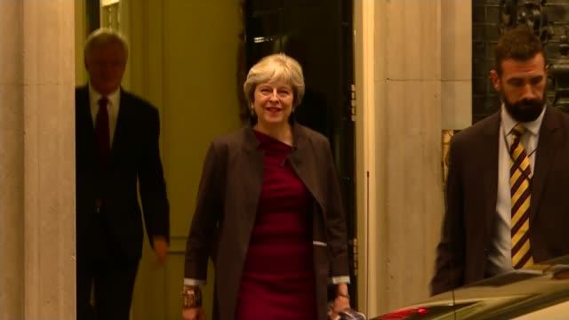 Theresa May and JeanClaude Juncker talks Downing Street Theresa May MP from 10 Downing Street and into car followed by David Davis MP Cars away