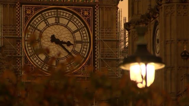 Theresa May and JeanClaude Juncker talks ENGLAND London Westminster EXT Long shot Big Ben clock face during orange sand storm
