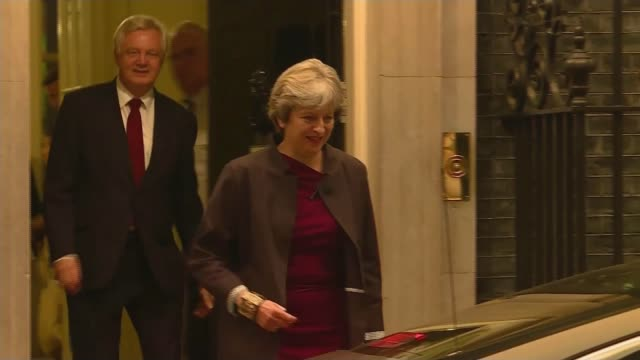 Theresa May and JeanClaude Juncker talks ENGLAND London Downing Street EXT Prime Minister Theresa May MP towards from Number 10 with David Davies MP